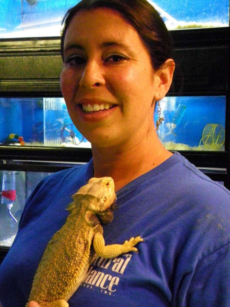 Steves Pets - Kristin Bateman, not squeamish, poses with a bearded dragon - photo by Kellie Flanagan
