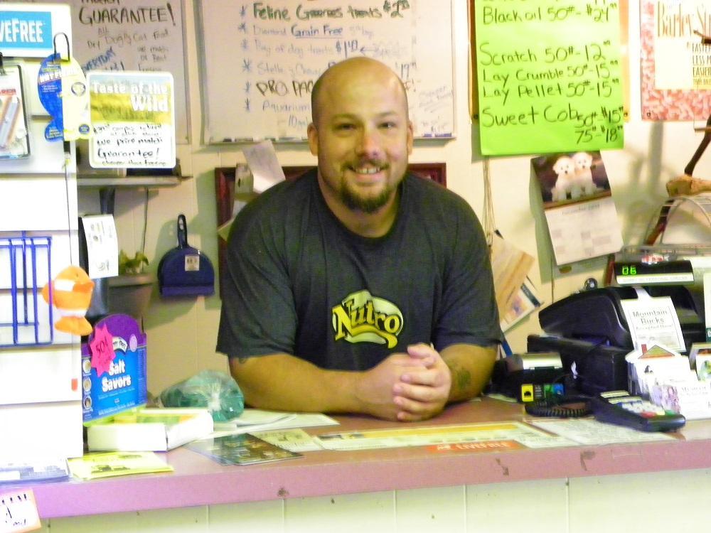 Steves Pets with Steve at the counter and all the specials posted behind him  - photo by Kellie Flanagan