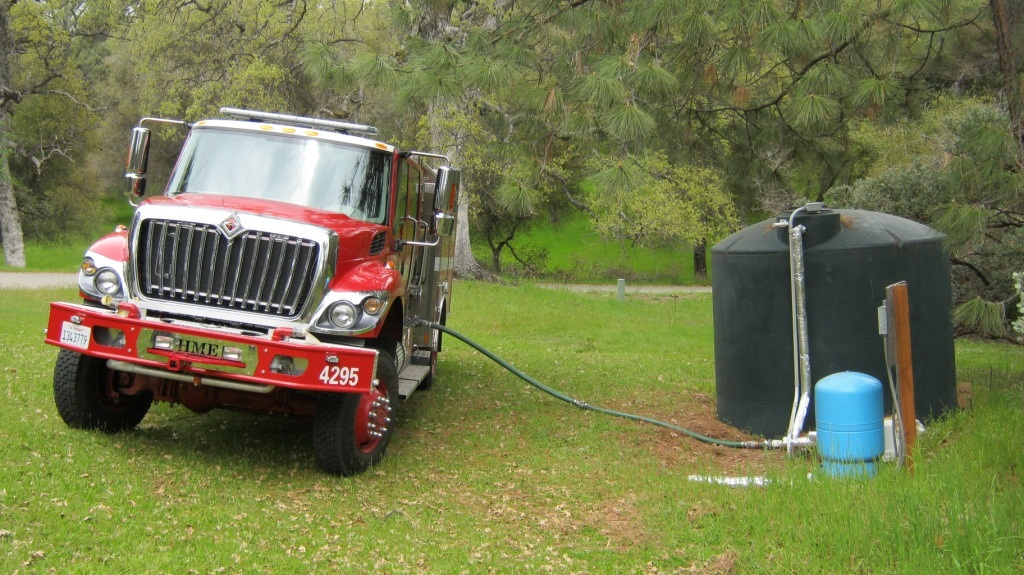 Engine 4295 accessing home water tank - photo Cal Fire