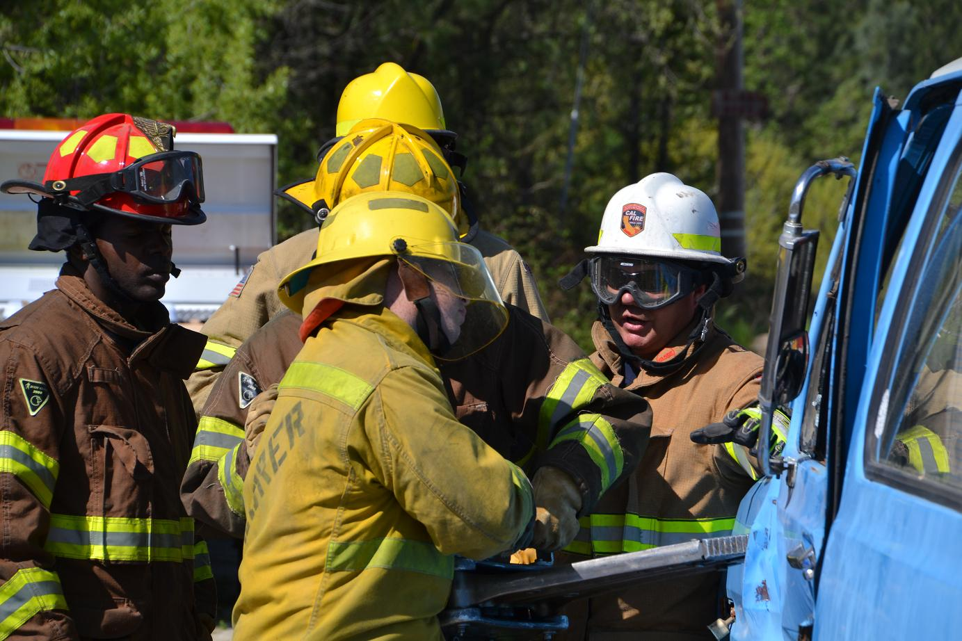 Battalion Chief Chris Christophers instructs on Jaws of Life - photo by Gina Clugston
