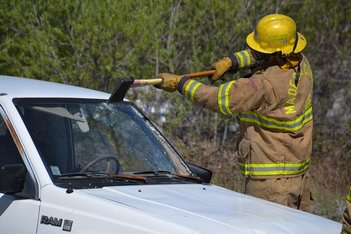 Cutting out the windshield with an axe - photo by Gina Clugston