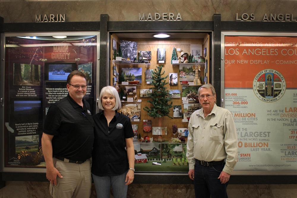 State display for Madera County with Lynn and Julie Fullmer and Jim Elliott
