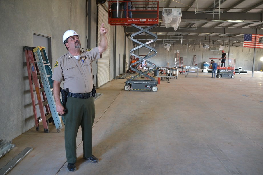 Mike Salvador touring the inside of the new Sheriffs Office