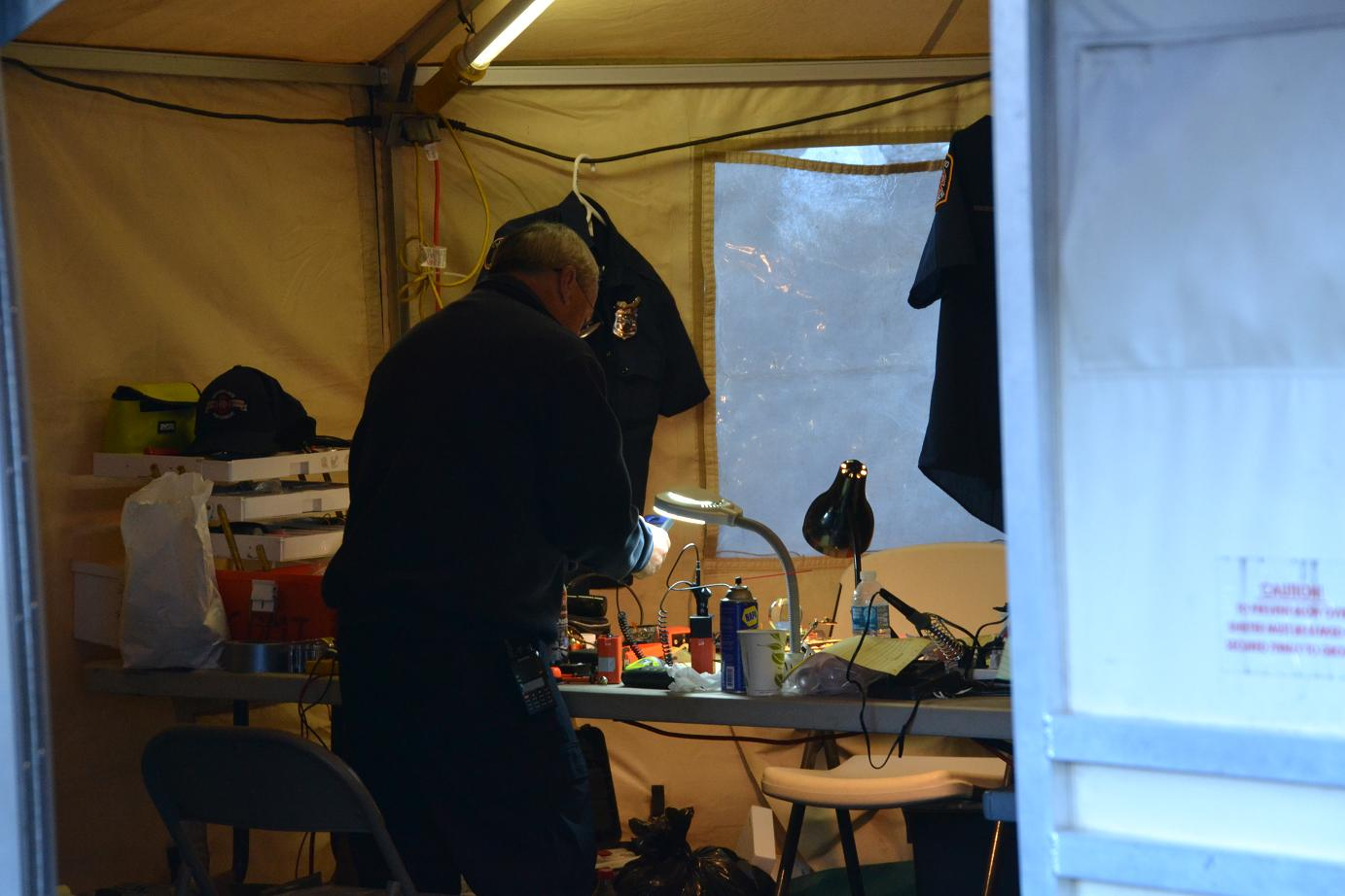 Radio Tech at fire camp - photo by Gina Clugston