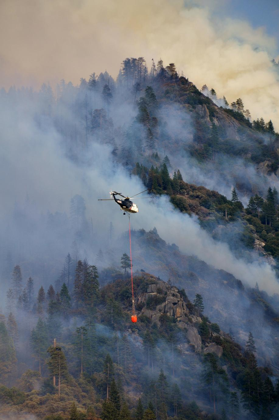 Large helicopter over steep terrain - photo by Gina Clugston