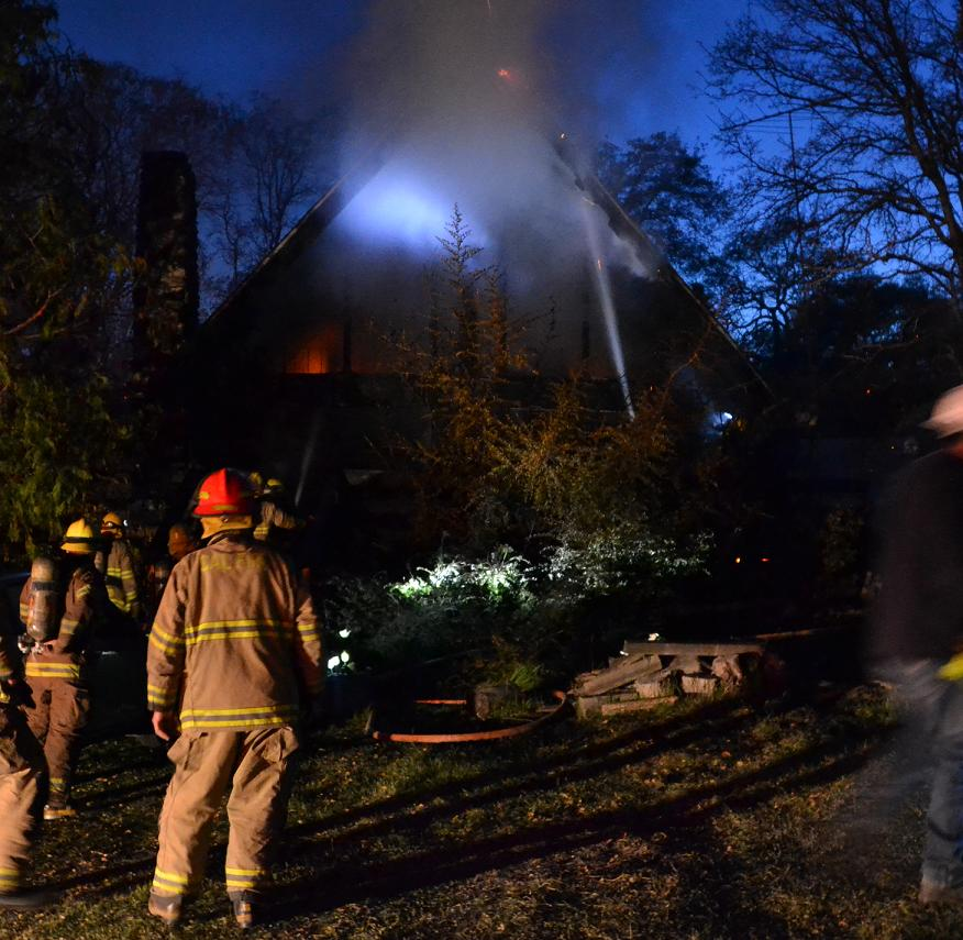 Firefighters putting water on house fire on Blackfoot Road - photo by Gina Clugston