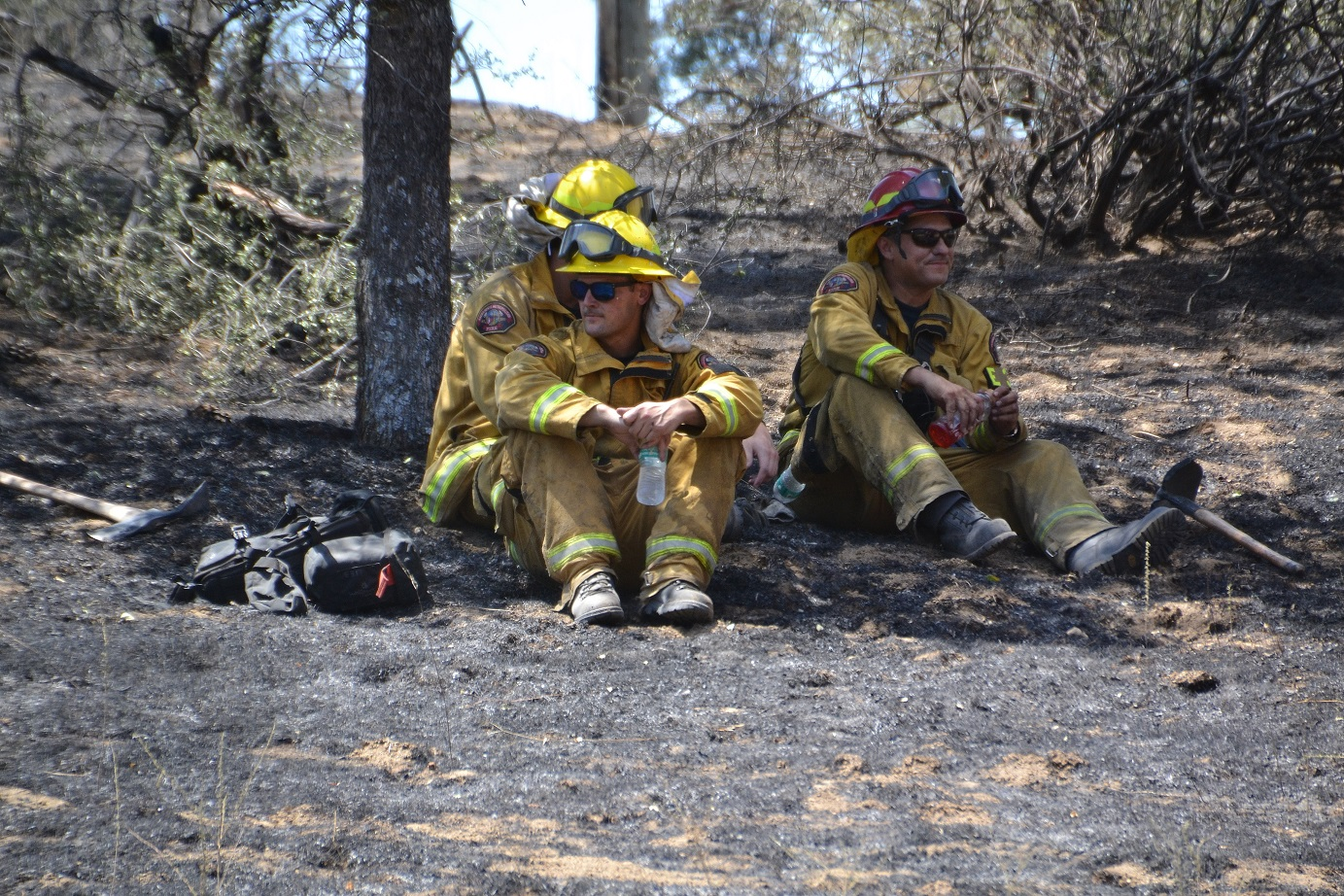 Firefighters taking a break from a hot dirty job - photo by Gina Clugston