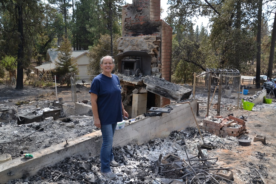 Vicki Lura at the remains of her home