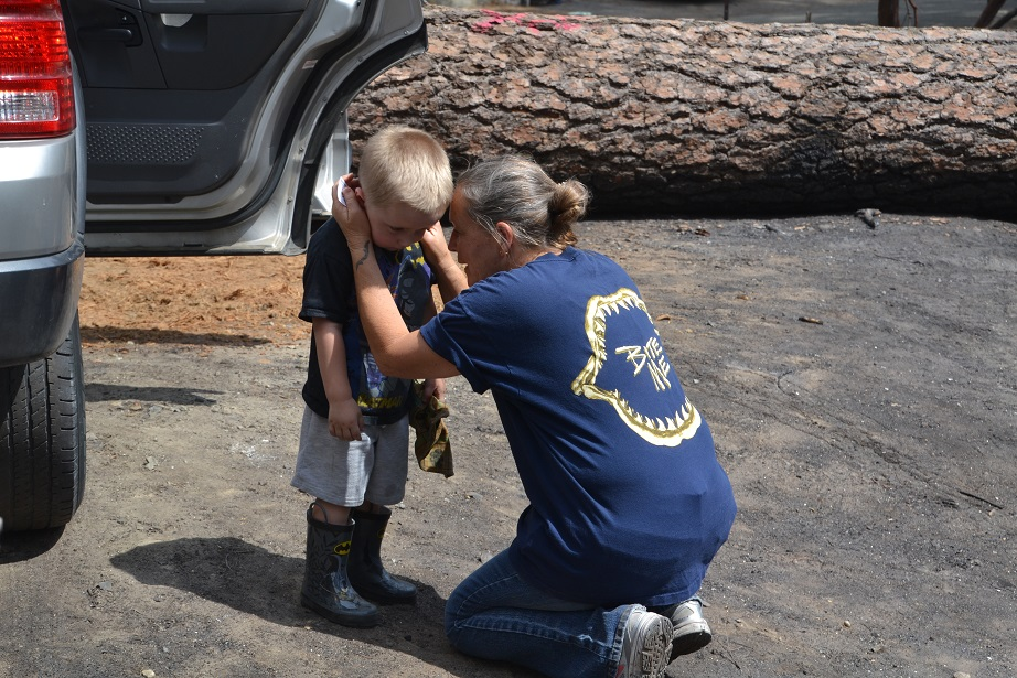 Vicki Lura comforts her grandson after Courtney Fire