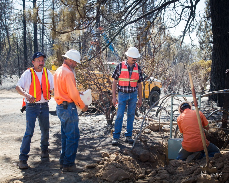 Courtney Fire -Sierra Tel crews and other contractors work on lines where home has burned - photo by Virginia Lazar Sept. 16 2014