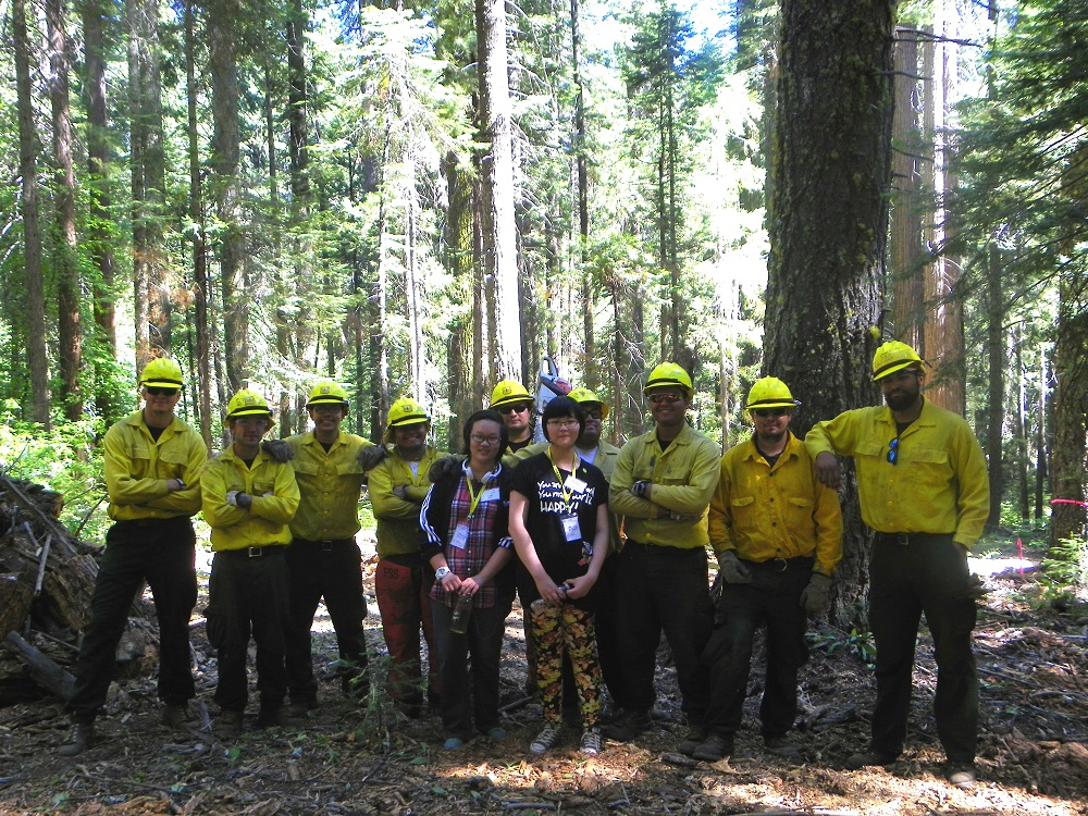Men from Forest Service Fresno 4 Crew in Nelder Grove pose with Chinese Sierra Homestay Students Queen and Polly  - 2014 - photo by Kellie Flanagan