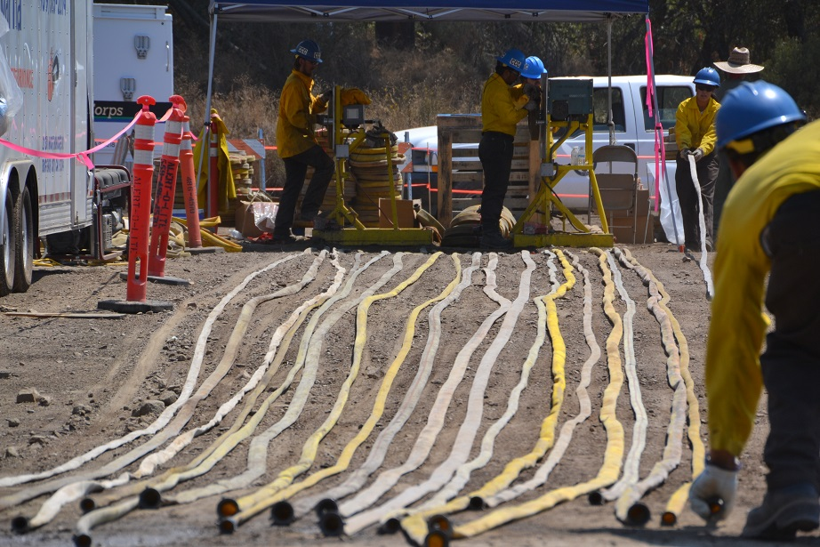 Fire Hose being rolled for transport