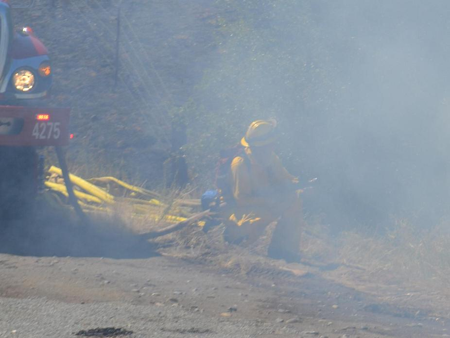 Engine 4275 and firefighter in the smoke