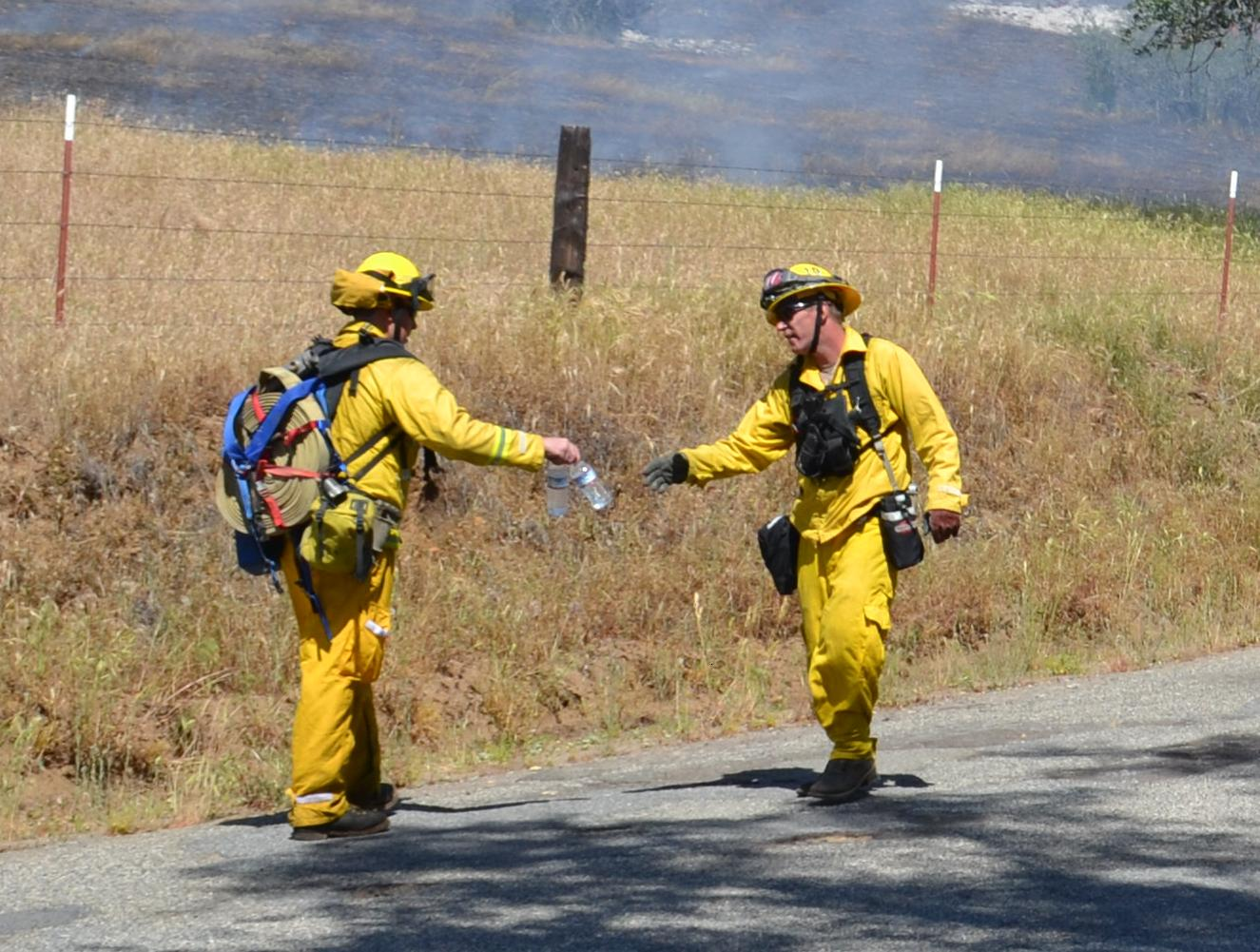 Firefighters share water bottles