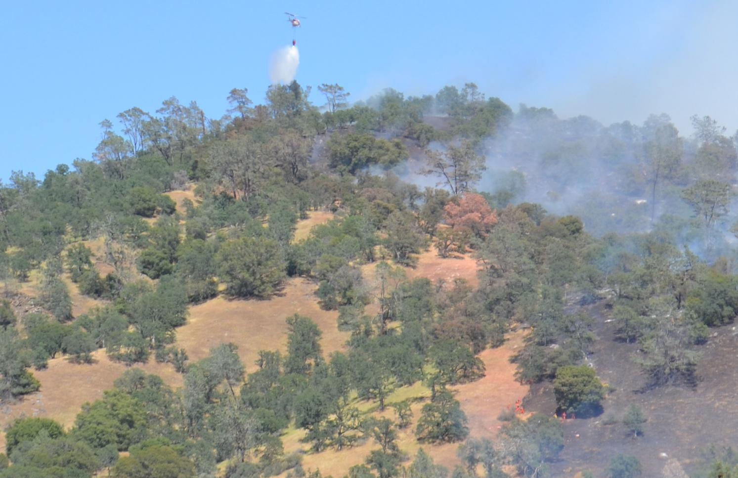 Helicopter and crews on fire line