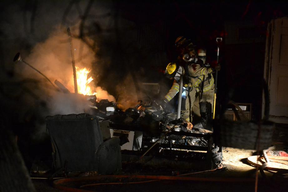 Firefighters work through the debris - photo by Gina Clugston