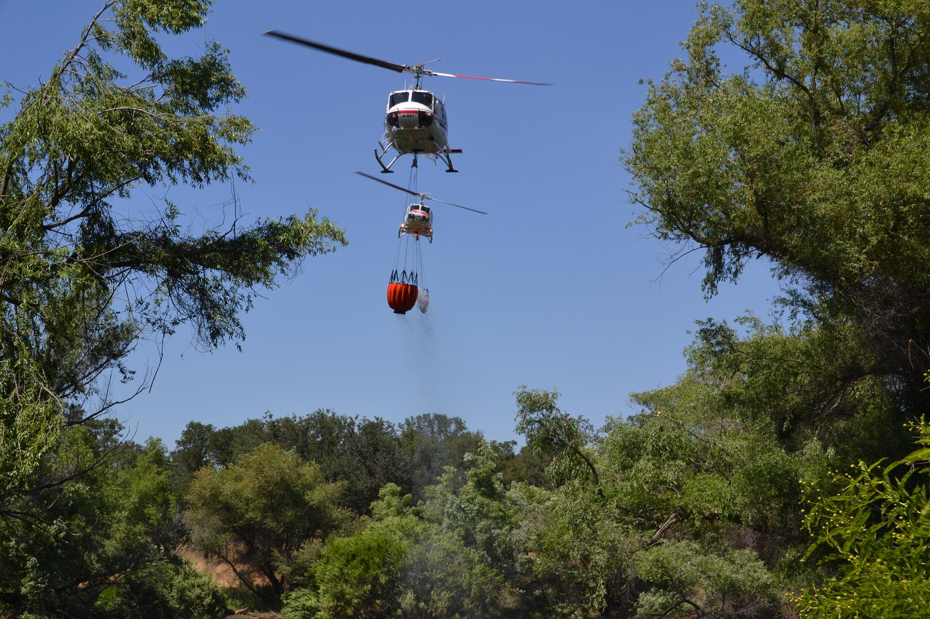 Helicopters H-551 and Cal Fire 404 - photo by Gina Clugston