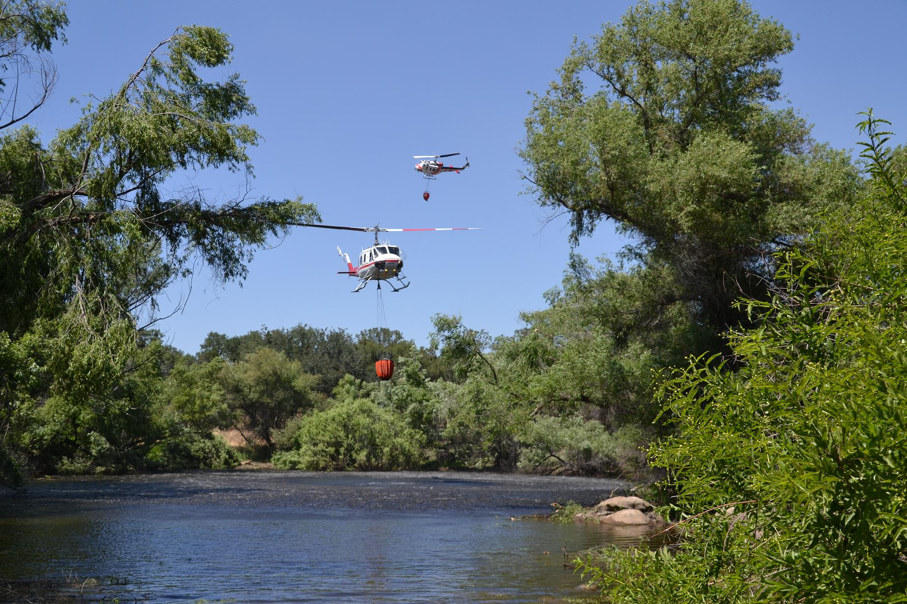 Helicopters tag teaming over the pond - Photo by Gina Clugston