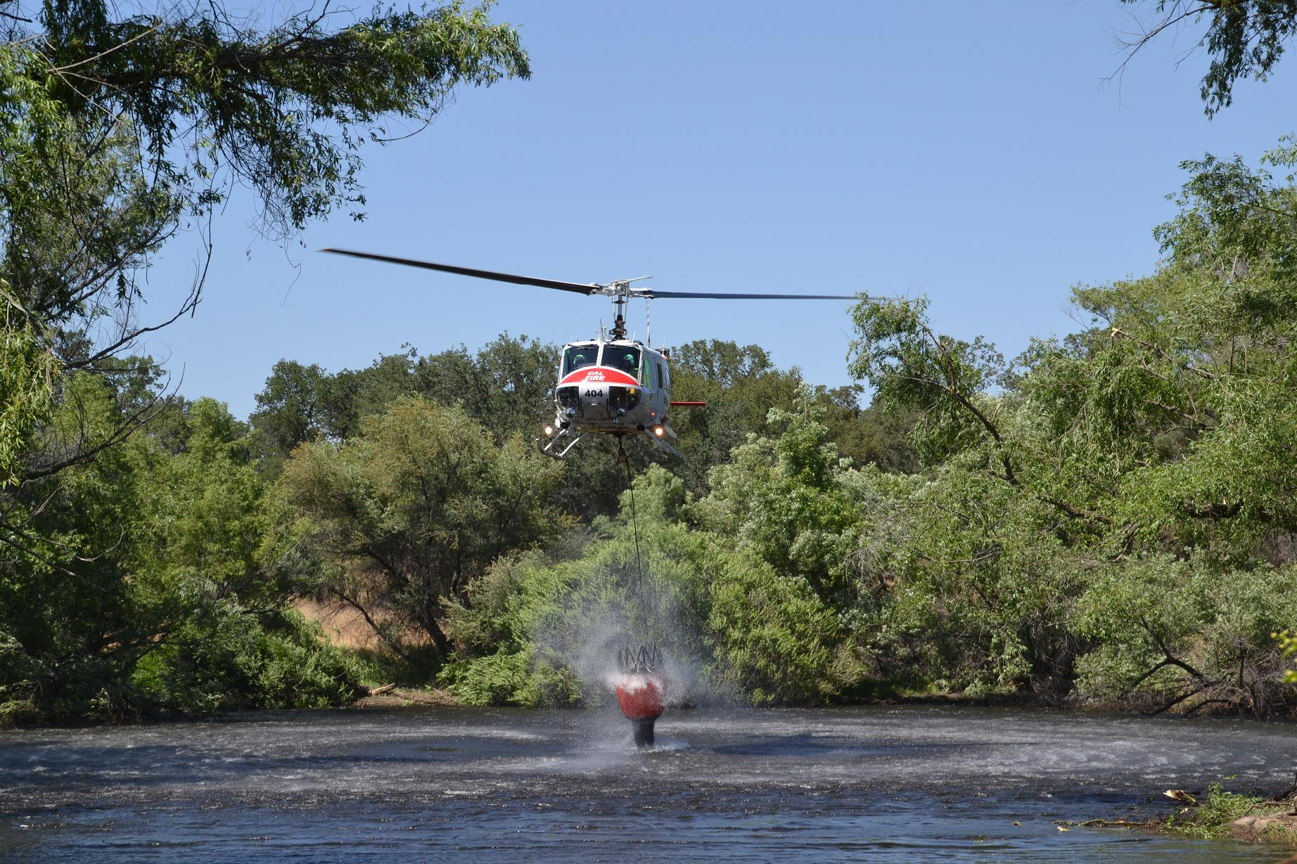 Water sprays as helicopter loads photo by Gina Clugston