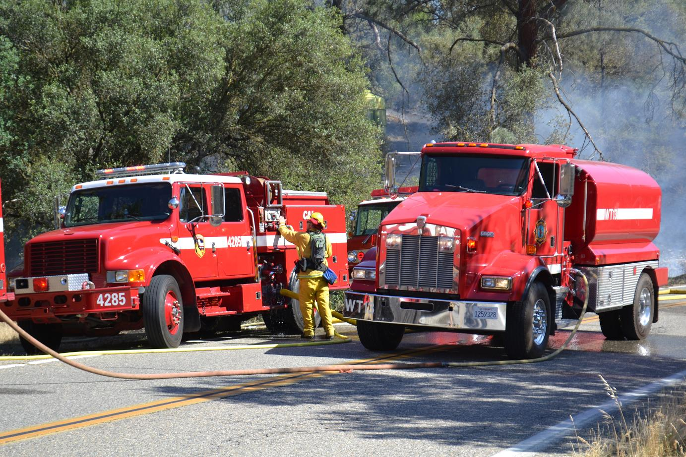 Firefighters work along Road 400
