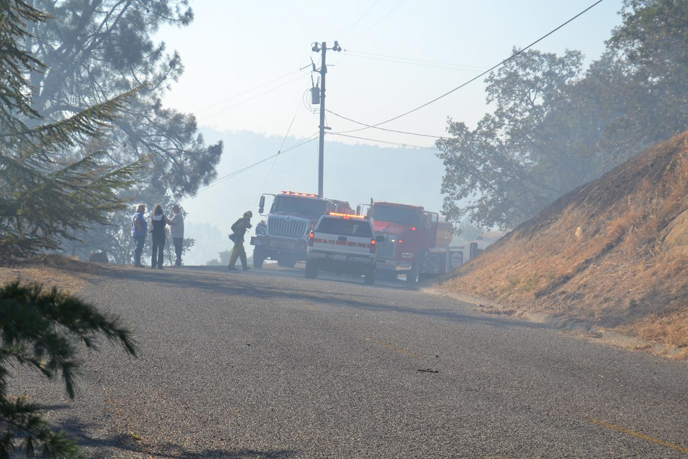 Residents and firefighters on Big River Way