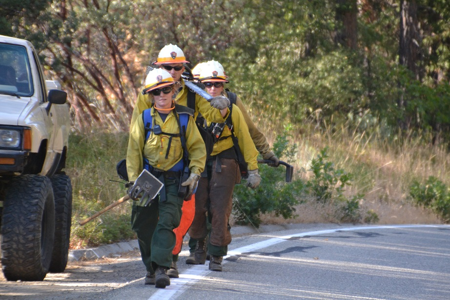 Park Service firefighters headed for the line on the Pines Fire