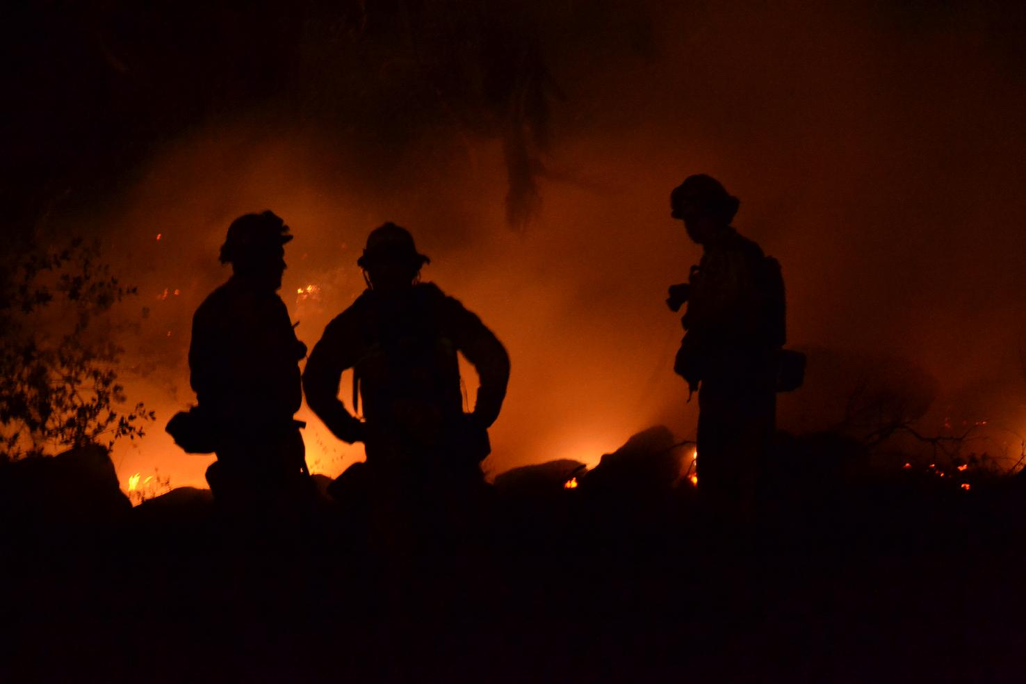 Three firefighters sillouette Revis Circle - photo by Gina Clugston