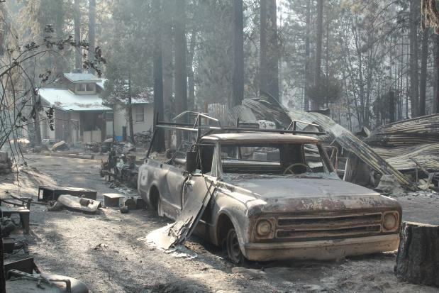Pickup and Outbuilding on Rim Fire - photo USFS Mike McMillan