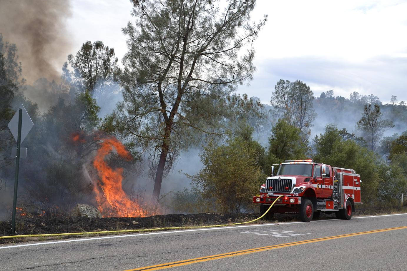 Engine 2764 near flames on Road 400
