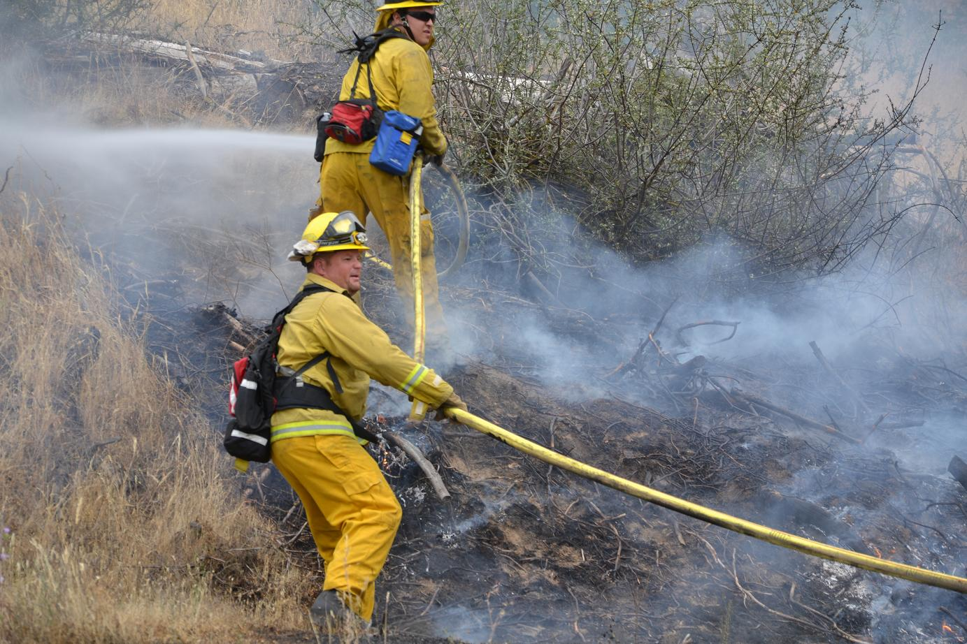 Firefighters on Road 400 fire