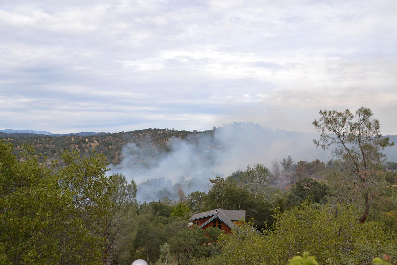Homes threatened ahead of fire