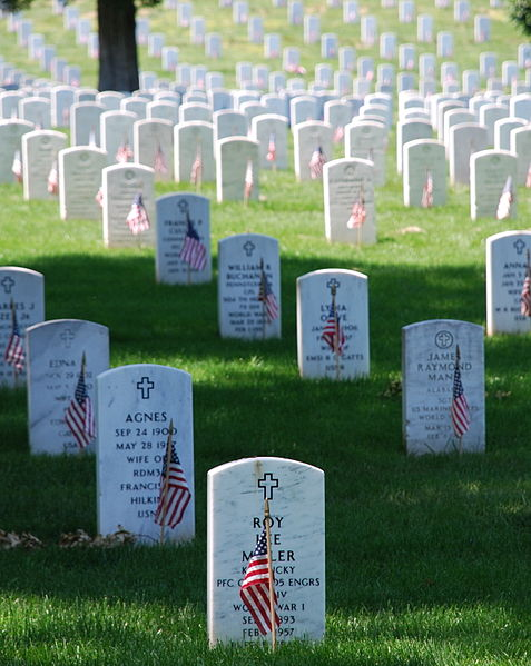 The gravestones at Arlington National Cemetery are decorated by U.S. flags on Memorial Day weekend - Commons