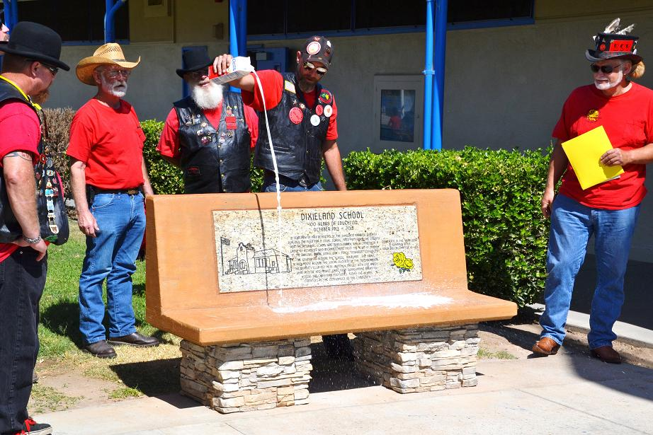 Dedicating the bench at Dixieland School with milk