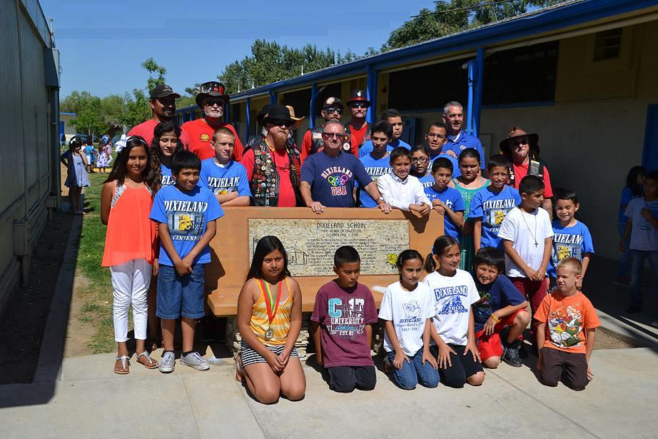Kids and Clampers with new bench monument at Dixieland School