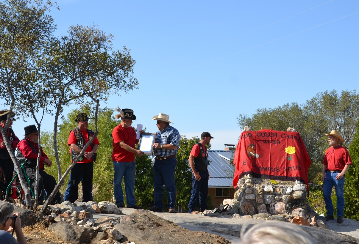 Assemblyman Frank Bigelow presents proclamation to Clampers at Hildreth Monument - photo by Gina Clugston