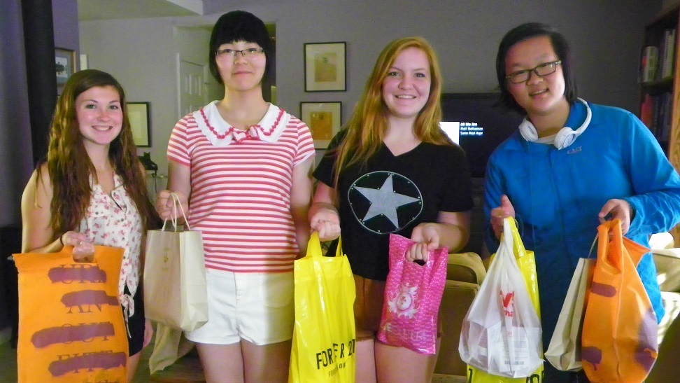 L-R Allie Queen Clara Polly return from a successful shopping trip to Fresno - Sierra Homestay Students 2014 - photo by Kellie Flanagan