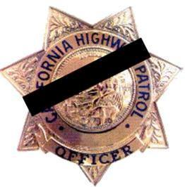 CHP badge with mourning band