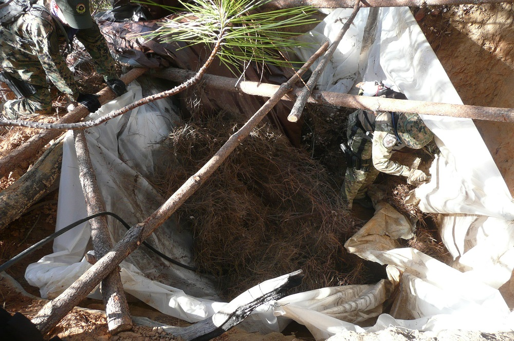 Illegal pot grow cleanup - cleanup team exposes where the growers formerly mixed chemicals with water diverted from stream nearby - photo courtesy SNAMP