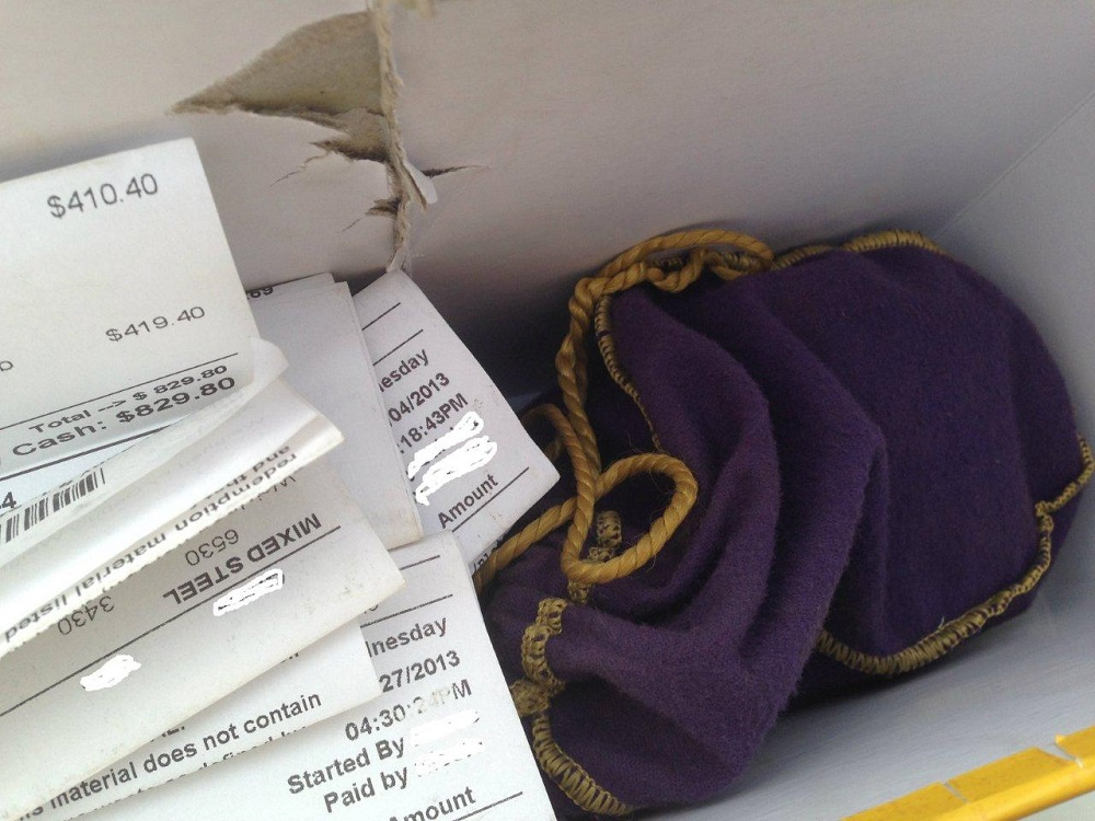 Coarsegold box containing scrap receipts and drug bag
