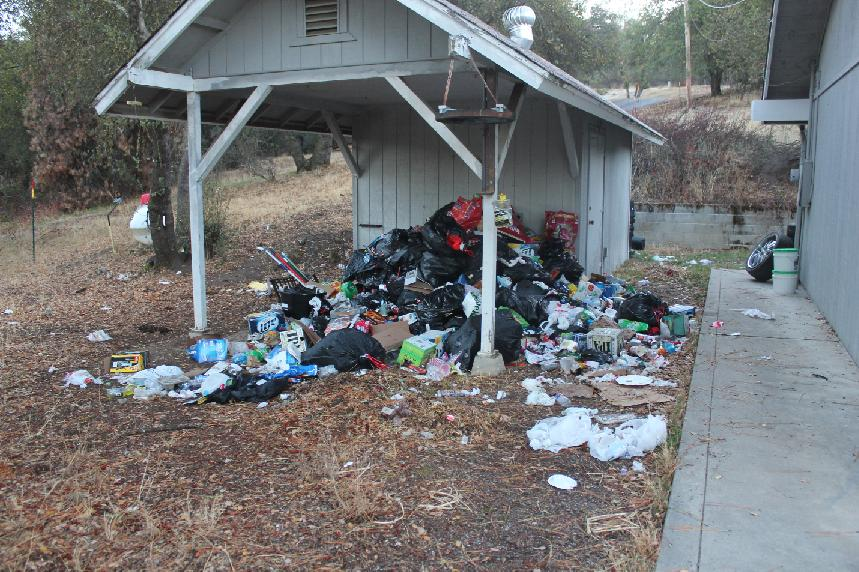 Trash outside the house - photo Madco Sheriffs Office