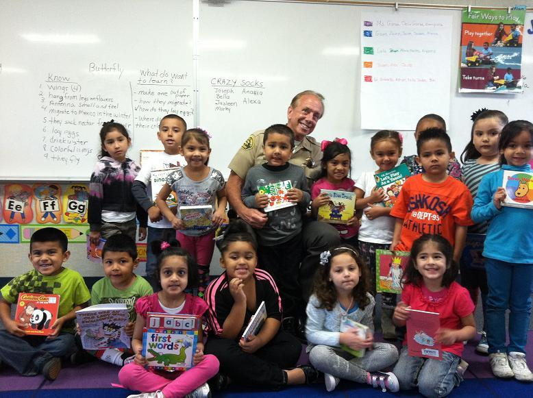 Sheriff Anderson with kids at Alpha II Preschool 4-17-13