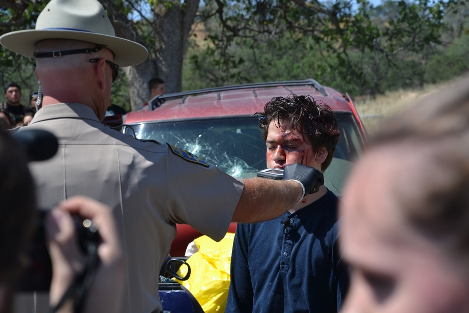 DUI driver takes breathalizer - photo by Gina Clugston