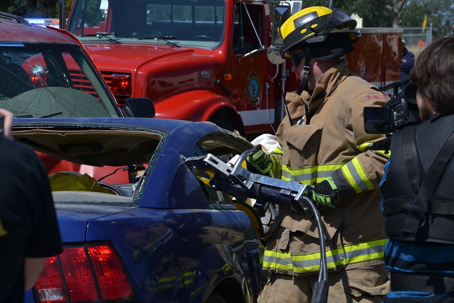 Firefighter uses Jaws of Life to free passenger - photo by Gina Clugston