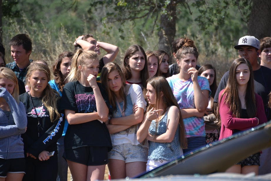 Students watch as crash scene plays out - photo by Gina Clugston
