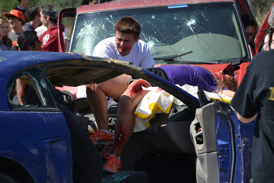 Teen driver trying to revive unconscious passenger - photo by Gina Clugston