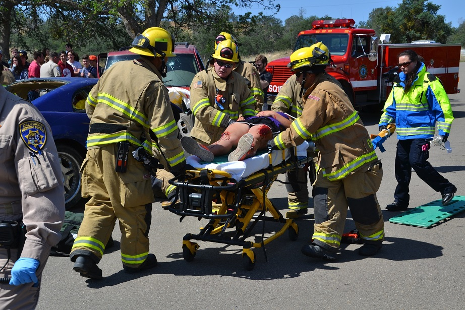 Transporting fatally injured teen to air ambulance - photo by Gina Clugston