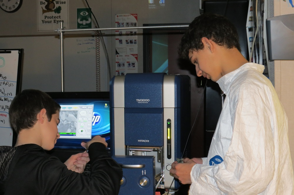 Cristian Mendoza and Jonathan Gramajo check out the scanning electron microscope on loan to Glacier High - 2014 - photo courtesy Brook Bullock Mountain Home Charter School