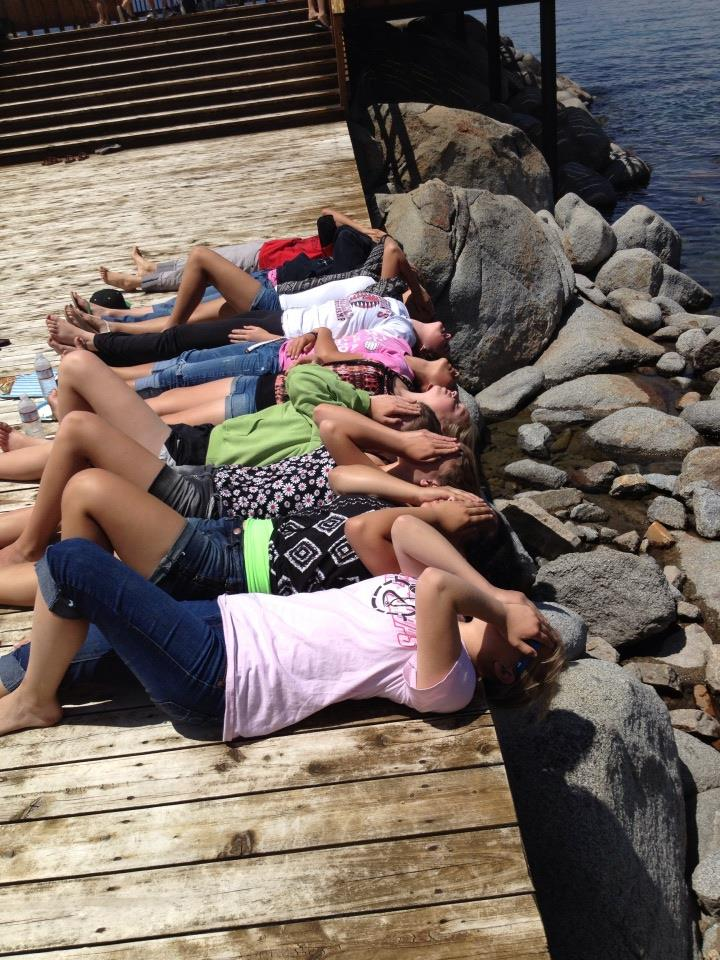 Yosemite Badgers Girls Basketball in Tahoe had a good time off the court as well lying on the docks - photo by Stacey Montalto 2014