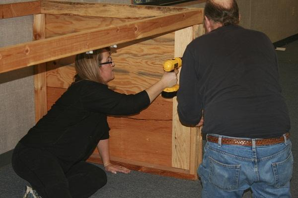Parent Ronda Clarke tackles carpentry at OCI Day of Service