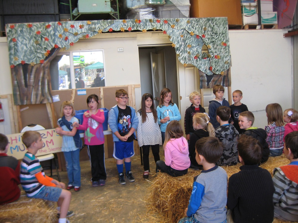 Earth Day for OES Students - kids recite an environmental rap for customers at Oakhurst Feed - photo courtesy of Kathleen Murphy OES Principal 2014